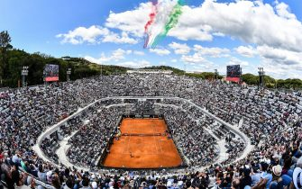 TOPSHOT - The Frecce Tricolori air squadron flies over the Foro Italico as Serbia's Novak Djokovic plays against Canada's Denis Shapovalov during their ATP Masters tournament tennis match in Rome on May 16, 2019. (Photo by Andreas SOLARO / AFP)        (Photo credit should read ANDREAS SOLARO/AFP via Getty Images)