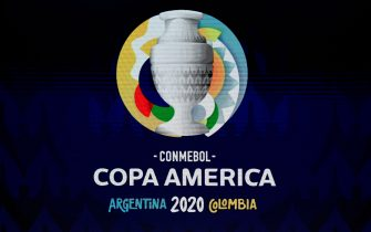 A screen displays the logo of the Copa America 2020 during the draw of the football tournament at the Convention Centre in Cartagena, Colombia, on December 3, 2019. - The Copa America 2020 football tournament will be held jointly by Argentina and Colombia next year from June 12 to July 12. Asian champions Qatar and previous winner Australia will participate as invited guest teams. (Photo by Juan BARRETO / AFP) (Photo by JUAN BARRETO/AFP via Getty Images)