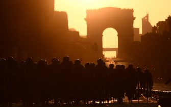 TOPSHOT - Cyclists ride dwon the Champs Elysees avenue with the Arc de Triomphe in background during the 21st and last stage of the 106th edition of the Tour de France cycling race between Rambouillet and Paris Champs-Elysees, in Paris on July 28, 2019. (Photo by Marco Bertorello / AFP)        (Photo credit should read MARCO BERTORELLO/AFP via Getty Images)