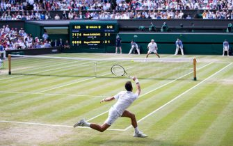 LONDON, ENGLAND - JULY 14: Novak Djokovic of Serbia in action during the Men's Singles Final against Roger Federer of Switzerland at The Wimbledon Lawn Tennis Championship at the All England Lawn and Tennis Club at Wimbledon on July 14, 2019 in London, England. (Photo by Simon Bruty/Anychance/Getty Images)