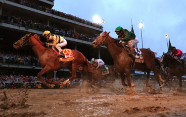 LOUISVILLE, KENTUCKY - MAY 04: Country House #20, ridden by jockey Flavien Prat, crosses the finish line to win the 145th running of the Kentucky Derby at Churchill Downs on May 04, 2019 in Louisville, Kentucky. Country House #20 was declared the winner after a stewards review disqualified Maximum Security #7. (Photo by Rob Carr/Getty Images)
