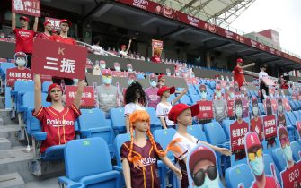 Mannequins and fake masked audience placards are placed at the Taoyuan Baseball stadium before the opening match for the Chinese Professional Baseball League (CPBL) in Taoyuan on April 11, 2020. - The match is called off due to the heavy rain. (Photo by Alex Lee / AFP) (Photo by ALEX LEE/AFP via Getty Images)