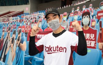 TAOYUAN, TAIWAN - APRIL 11: Singer Richie Jen Hsien-chi poses with Cardboard cutouts of fans prior the CPBL season opening game between Rakuten Monkeys and CTBC Brothers at Taoyuan International Baseball Stadium on April 11, 2020 in Taoyuan, Taiwan. (Photo by Gene Wang/Getty Images)