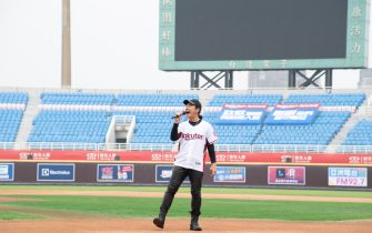TAOYUAN, TAIWAN - APRIL 11: Singer Richie Jen Hsien-chi singing prior to the CPBL season opening game between Rakuten Monkeys and CTBC Brothers at Taoyuan International Baseball Stadium on April 11, 2020 in Taoyuan, Taiwan.Only Media and workers for both team can enter the game. (Photo by Gene Wang/Getty Images)