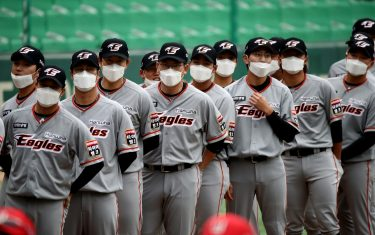 """INCHEON, SOUTH KOREA - MAY 05: (EDITORIAL USE ONLY) Hanwha Eagles players wear masks before the Korean Baseball Organization (KBO) League opening game between SK Wyverns and Hanwha Eagles at the empty SK Happy Dream Ballpark on May 05, 2020 in Incheon, South Korea. The 2020 KBO season started after being delayed from the original March 28 Opening Day due to the coronavirus (COVID-19) outbreak. The KBO said its 10 clubs will be able to expand their rosters from 28 to 33 players in 54 games this season, up from the usual 26. Teams are scheduled to play 144 games this year. As they prepared for the new beginning, 10 teams managers said the season would not be happening without the hard work and dedication of frontline medical and health workers. South Korea is transiting this week to a quarantine scheme that allows citizens to return to their daily routines under eased guidelines. But health authorities are still wary of """"blind spots"""" in the fight against the virus cluster infections and imported cases. According to the Korea Center for Disease Control and Prevention, 3 new cases were reported. The total number of infections in the nation tallies at 10,804. (Photo by Chung Sung-Jun/Getty Images)"""