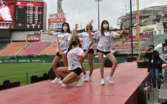 Cheerleaders pose during the opening game of South Korea's new baseball season between the SK Wyverns and Hanwha Eagles at Munhak Baseball Stadium in Incheon on May 5, 2020. - South Korea's professional sport returned to action on May 5 after the coronavirus shutdown with the opening of a new baseball season, while football and golf will soon follow suit in a ray of hope for suspended competitions worldwide. (Photo by Jung Yeon-je / AFP) (Photo by JUNG YEON-JE/AFP via Getty Images)