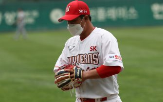 """INCHEON, SOUTH KOREA - MAY 05: (EDITORIAL USE ONLY) Choi jung of SK Wyverns pratice before the Korean Baseball Organization (KBO) League opening game between SK Wyverns and Hanwha Eagles at the empty SK Happy Dream Ballpark on May 05, 2020 in Incheon, South Korea. The 2020 KBO season started after being delayed from the original March 28 Opening Day due to the coronavirus (COVID-19) outbreak. The KBO said its 10 clubs will be able to expand their rosters from 28 to 33 players in 54 games this season, up from the usual 26. Teams are scheduled to play 144 games this year. As they prepared for the new beginning, 10 teams managers said the season would not be happening without the hard work and dedication of frontline medical and health workers. South Korea is transiting this week to a quarantine scheme that allows citizens to return to their daily routines under eased guidelines. But health authorities are still wary of """"blind spots"""" in the fight against the virus cluster infections and imported cases. According to the Korea Center for Disease Control and Prevention, 3 new cases were reported. The total number of infections in the nation tallies at 10,804. (Photo by Chung Sung-Jun/Getty Images)"""