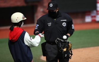 """INCHEON, SOUTH KOREA - MAY 05: (EDITORIAL USE ONLY) Home plate umpire wears a mask during the Korean Baseball Organization (KBO) League opening game between SK Wyverns and Hanwha Eagles at the empty SK Happy Dream Ballpark on May 05, 2020 in Incheon, South Korea. The 2020 KBO season started after being delayed from the original March 28 Opening Day due to the coronavirus (COVID-19) outbreak. The KBO said its 10 clubs will be able to expand their rosters from 28 to 33 players in 54 games this season, up from the usual 26. Teams are scheduled to play 144 games this year. As they prepared for the new beginning, 10 teams managers said the season would not be happening without the hard work and dedication of frontline medical and health workers. South Korea is transiting this week to a quarantine scheme that allows citizens to return to their daily routines under eased guidelines. But health authorities are still wary of """"blind spots"""" in the fight against the virus cluster infections and imported cases. According to the Korea Center for Disease Control and Prevention, 3 new cases were reported. The total number of infections in the nation tallies at 10,804. (Photo by Chung Sung-Jun/Getty Images)"""