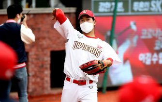 """INCHEON, SOUTH KOREA - MAY 05: (EDITORIAL USE ONLY) SK Wyverns players wear masks before the Korean Baseball Organization (KBO) League opening game between SK Wyverns and Hanwha Eagles at the empty SK Happy Dream Ballpark on May 05, 2020 in Incheon, South Korea. The 2020 KBO season started after being delayed from the original March 28 Opening Day due to the coronavirus (COVID-19) outbreak. The KBO said its 10 clubs will be able to expand their rosters from 28 to 33 players in 54 games this season, up from the usual 26. Teams are scheduled to play 144 games this year. As they prepared for the new beginning, 10 teams managers said the season would not be happening without the hard work and dedication of frontline medical and health workers. South Korea is transiting this week to a quarantine scheme that allows citizens to return to their daily routines under eased guidelines. But health authorities are still wary of """"blind spots"""" in the fight against the virus cluster infections and imported cases. According to the Korea Center for Disease Control and Prevention, 3 new cases were reported. The total number of infections in the nation tallies at 10,804. (Photo by Chung Sung-Jun/Getty Images)"""
