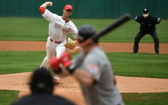 SK Wyverns pitcher Nick Kingham (top L) throws against the Hanwha Eagles in the first inning of the opening game for South Korea's new baseball season at Munhak Baseball Stadium in Incheon on May 5, 2020. - South Korea's professional sport returned to action on May 5 after the coronavirus shutdown with the opening of a new baseball season, while football and golf will soon follow suit in a ray of hope for suspended competitions worldwide. (Photo by Jung Yeon-je / AFP) (Photo by JUNG YEON-JE/AFP via Getty Images)