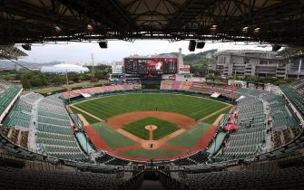 """INCHEON, SOUTH KOREA - MAY 05: (EDITORIAL USE ONLY) General view of the Korean Baseball Organization (KBO) League opening game between SK Wyverns and Hanwha Eagles at the empty SK Happy Dream Ballpark on May 05, 2020 in Incheon, South Korea. The 2020 KBO season started after being delayed from the original March 28 Opening Day due to the coronavirus (COVID-19) outbreak. The KBO said its 10 clubs will be able to expand their rosters from 28 to 33 players in 54 games this season, up from the usual 26. Teams are scheduled to play 144 games this year. As they prepared for the new beginning, 10 teams managers said the season would not be happening without the hard work and dedication of frontline medical and health workers. South Korea is transiting this week to a quarantine scheme that allows citizens to return to their daily routines under eased guidelines. But health authorities are still wary of """"blind spots"""" in the fight against the virus cluster infections and imported cases. According to the Korea Center for Disease Control and Prevention, 3 new cases were reported. The total number of infections in the nation tallies at 10,804. (Photo by Chung Sung-Jun/Getty Images)"""