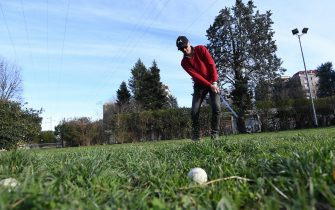 An amateur golfer practices training shots in a small public park due to the closure of the golf club where he is registered and for the limitations of mobility contained in the decree that, from yesterday evening, extends the restrictive measures to stop the spread of Coronavirus throughout Italy, Milan, 10 March 2020. In an attempt to stop the spreading of the novel coronavirus Covid-19, Italian Prime Minister Conte announced on 09 March the extending of coronavirus quarantine measures to the entire country starting on 10 March until 03 April. It will be possible to move only for 'proven work reasons' or 'serious family or health needs', he said. All public gatherings have been banned and people have been advised to stay at home. ANSA/DANIEL DAL ZENNARO