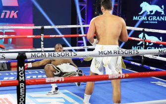 LAS VEGAS, NEVADA - JUNE 09: In this handout image provided by Top Rank, Guido Vianello knocks down Don Haynesworth during their heavyweight bout at MGM Grand Conference Center Grand Ballroom on June 09, 2020 in Las Vegas, Nevada. (Photo by Mikey Williams/Top Rank via Getty Images)