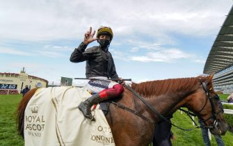 ASCOT, ENGLAND - JUNE 18:  Frankie Dettori celebrates after riding Stradivarius to win The Gold Cup for the third time in a row on Day Three of Royal Ascot at Ascot Racecourse on June 18, 2020 in Ascot, England. The Queen will miss out on attending Royal Ascot in person for the first time in her 68 year reign. Her Majesty is reported to be planning to watch the racing from home at Windsor Castle, but she will not be able to attend, as the meet goes on behind closed doors due to the Covid-19 pandemic. (Photo by Alan Crowhurst/Getty Images)