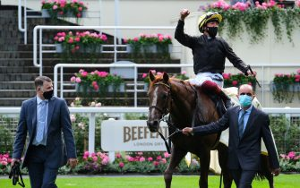 ASCOT, ENGLAND - JUNE 18:  Stradivarius and Frankie Dettori are lead into the winners enclosure after victory in the Gold Cup during Day 3 of Royal Ascot at Ascot Racecourse on June 18, 2020 in Ascot, England.  (Photo by Megan Ridgwell/Pool via Getty Images)