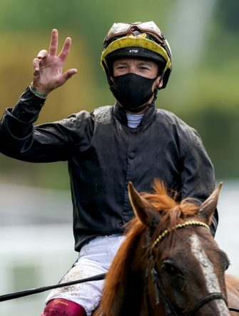 ASCOT, ENGLAND - JUNE 18:  Frankie Dettori gives the three fingers sign after riding Stradivarius to his third straight win in The Gold Cup on Day Three of Royal Ascot at Ascot Racecourse on June 18, 2020 in Ascot, England. The Queen will miss out on attending Royal Ascot in person for the first time in her 68 year reign. Her Majesty is reported to be planning to watch the racing from home at Windsor Castle, but she will not be able to attend, as the meet goes on behind closed doors due to the Covid-19 pandemic. (Photo by Alan Crowhurst/Getty Images)