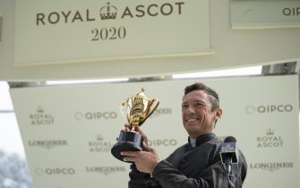 ASCOT, ENGLAND - JUNE 18: Frankie Dettori celebrates with the trophy after riding Stradivarius to win his third Gold Cup during Day Three of Royal Ascot 2020 at Ascot Racecourse on June 18, 2020 in Ascot, England. (Photo by Edward Whitaker/Pool via Getty Images)