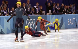 16 Feb 2002:  Australia's first ever Winter Gold medal winner Steven Bradbury crosses the line while America's Apolo Anton Ohno scrambles for the line to claim second place after the men's 1000m speed skating final during the Salt Lake City Winter Olympic Games at the Salt Lake Ice Center in Salt Lake City, Utah. DIGITAL IMAGE.  Mandatory Credit: Steve Munday/Getty Images