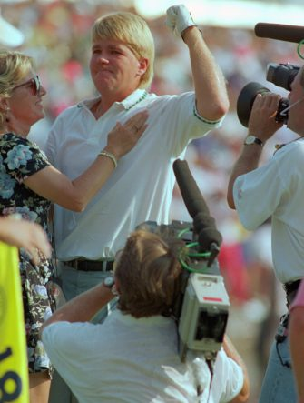 (Original Caption) Carmel, Ind.: PGA Champion John Daly and fiance Betty Fulton celebrate on the 18th green after Daly won the 73rd PGA Championship at Crooked Stick Country Club. Daly picked up $230,000 for his first major win.