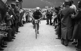 Italian Gino Bartali rides uphill in the Col de la Forclaz on his way to winning the 15th stage of the Tour de France between Aix-les-Bains and Lausanne (Switzerland) on July 18, 1948. Bartali won his third consecutive stage in the Alps, taking the yellow jersey from Frenchman Louison Bobet the day before. Gino Bartali won seven stages overall to capture his second Tour de France, ten years after his first win, a record gap for a rider.        (Photo credit should read STAFF/AFP via Getty Images)