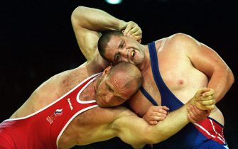 379348 01: Rulon Gardner of USA, right, wrestles against Alexandre Karelin of Russia in the 130 kilogram event September 27, 2000 during the Sydney 2000 Olympic Games in Sydney, Australia. In this major upset, Gardner defeated Karelin to win the gold medal. Kareline had not lost an International match in 13 years up until this defeat. (Photo by Billy Stickland/Allsport)