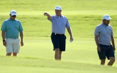 MALELANE, SOUTH AFRICA - NOVEMBER 28:  Richard Sterne of South Africa (l) , Ernie Els of South Africa  (c) and George Coetzee of South Africa  (r) walk down the fairway in shorts during Day One of the Alfred Dunhill Championship at Leopard Creek Country Golf Club on November 28, 2019 in Malelane, South Africa. (Photo by Jan Kruger/Getty Images)