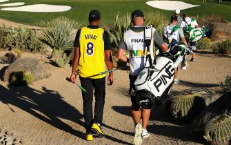 SCOTTSDALE, ARIZONA - JANUARY 30:  Tony Finau walks down the 16th hole while wearing a jersey of former NBA player Kobe Bryant during the first round of the Waste Management Phoenix Open at TPC Scottsdale on January 30, 2020 in Scottsdale, Arizona. Bryant and his 13-year old daughter were among nine passengers killed in a helicopter crash on January 26, 2020. (Photo by Christian Petersen/Getty Images)