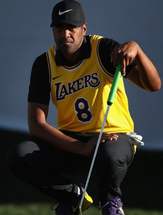 SCOTTSDALE, ARIZONA - JANUARY 30:  Tony Finau lines up a putt on the 16th green while wearing a jersey of former NBA player Kobe Bryant during the first round of the Waste Management Phoenix Open at TPC Scottsdale on January 30, 2020 in Scottsdale, Arizona. Bryant and his 13-year old daughter were among nine passengers killed in a helicopter crash on January 26, 2020. (Photo by Christian Petersen/Getty Images)