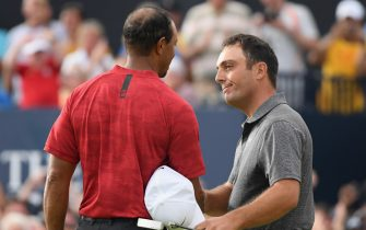 CARNOUSTIE, SCOTLAND - JULY 22:  Francesco Molinari of Italy (R) is congratulated by Tiger Woods of the United States after a birdie on the 18th hole during the final round of the 147th Open Championship at Carnoustie Golf Club on July 22, 2018 in Carnoustie, Scotland.  (Photo by Harry How/Getty Images)