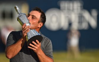 TOPSHOT - Italy's Francesco Molinari kisses the trophy as he poses for pictures with the Claret Jug, the trophy for the Champion golfer of the year after winning the 147th Open golf Championship at Carnoustie, Scotland on July 22, 2018. (Photo by Glyn KIRK / AFP)        (Photo credit should read GLYN KIRK/AFP via Getty Images)