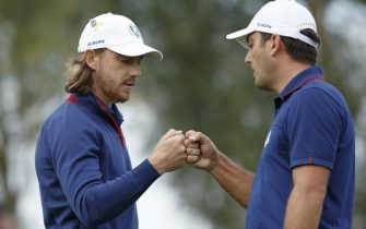 Tommy Fleetwood and Francesco Molinari celebrate a birdie on the 4th hole in their morning four-ball match versus Reed and Woods during the 2018 Ryder Cup at Le Golf National near Versailles on September 28th 2018 in France (Photo by Tom Jenkins)