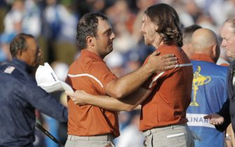 Francesco Molinari and Tommy Fleetwood of Europe celebrate victory on the 15th green in their afternoon foursomes match versus Tiger Woods and Bryson DeChambeau of USA during day two of the 2018 Ryder Cup at Le Golf National near Versailles on September 29th 2018 in France (Photo by Tom Jenkins)