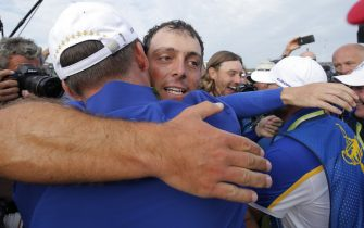 Francesco Molinari hugs Paul Casey after winning his match and the Ryder Cup on the 16th tee during day three of the 2018 Ryder Cup at Le Golf National near Versailles on September 30th 2018 in France (Photo by Tom Jenkins)