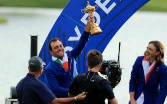 PARIS, FRANCE - SEPTEMBER 30: Francesco Molinari of Itlay and the European Team raises the Ryder Cup watched by Tommy Fleetwood after their 17.5-10.5 win over the United States during the singles matches of the 2018 Ryder Cup at Le Golf National on September 30, 2018 in Paris, France.  (Photo by David Cannon/Getty Images)