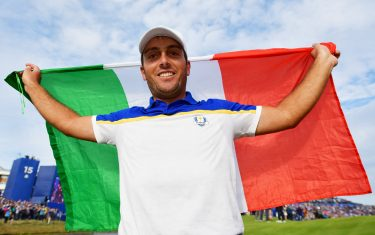 PARIS, FRANCE - SEPTEMBER 30: Francesco Molinari of Europe celebrates winning The Ryder Cup with an Italian flag during singles matches of the 2018 Ryder Cup at Le Golf National on September 30, 2018 in Paris, France.  (Photo by Stuart Franklin/Getty Images)