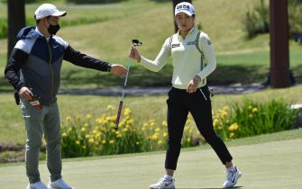 South Korean golfer Lee Jeong-eun (R) participates in a practice session on the 18th green ahead of the 42nd KLPGA Championship at Lakewood Country Club in Yangju, northeast of Seoul, on May 13, 2020. - Leading professional golfers will return to competitive action for the first time in months after the coronavirus shutdown when three of the world's top 10 women tee off in South Korea on May 14. (Photo by Jung Yeon-je / AFP) (Photo by JUNG YEON-JE/AFP via Getty Images)
