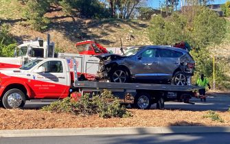 The vehicle driven by Tiger Woods on the back of a truck in Los Angeles after he suffered leg injuries when the vehicle rolled over and is now in hospital undergoing surgery. Picture date: Tuesday February 23, 2021.