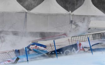 Blown fences and banners are pictured in the finish area of the FIS Alpine Ski Women's Giant Slalom World Cup event in Semmering, Austria, on December 28, 2020. - The Alpine Skiing World Cup in Semmering, whose first run was contested in the morning, was called off due to the wind blowing over the Austrian resort, the International Ski Federation (FIS) announced on December 28. (Photo by Erich SPIESS / various sources / AFP) / Austria OUT (Photo by ERICH SPIESS/EXPA/AFP via Getty Images)