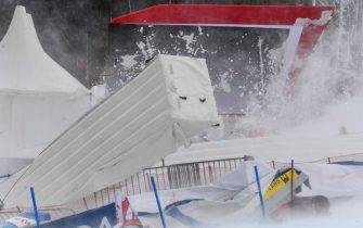 Blown fences and banners are pictured in the finish area ahead the FIS Alpine Ski Women's Giant Slalom World Cup event in Semmering, Austria, on December 28, 2020. - The Alpine Skiing World Cup in Semmering, whose first run was contested in the morning, was called off due to the wind blowing over the Austrian resort, the International Ski Federation (FIS) announced on December 28. (Photo by Erich SPIESS / various sources / AFP) / Austria OUT (Photo by ERICH SPIESS/EXPA/AFP via Getty Images)