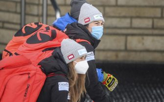 epa08907664 Athletes leave the venue ahead of the second run of the Women's Giant Slalom race at the FIS Alpine Skiing World Cup in Semmering, Austria, 28 December 2020.  The race was cancelled due to strong wind.  EPA/CHRISTIAN BRUNA