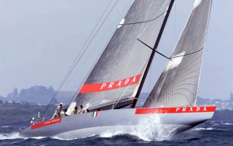 AUC05D:SPORT-YACHTING-AMERICAS:AUCKLAND,NEWZEALAND,29JAN00 - Italy's Prada ploughs through a wave at the start of race three of the Louis Vuitton Cup final against United States entry AmericaOne on the Hauraki Gulf in Auckland January 29. The best of nine series is tied at 1-1 with the overall winner challenging Team New Zealand for the Americas Cup which starts on February 19.   mdb/Photo by Mark  Baker       REUTERS
