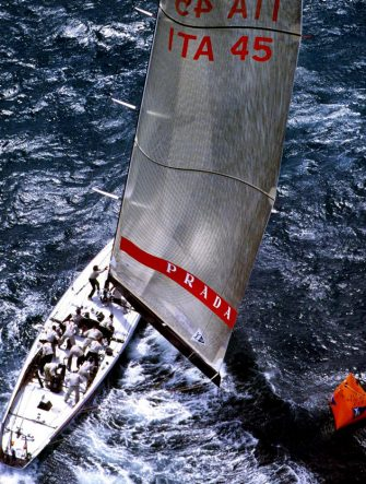"AKL06 - 20000201 - AUCKLAND, NEW ZEALAND : Prada's ""Luna Rossa"" in catch up mode tacks around the windward mark in pursuit of the Saint Francis Yacht Club's ""America One"" on race day five of the Louis Vuitton Cup finals in Auckland, 01 February, 2000.  America One won by 34 seconds.  Prada leads the series with three wins to two in the best of nine match finals to determine who goes on to challenge Team New Zealand for the America's Cup on the 19th of February.  