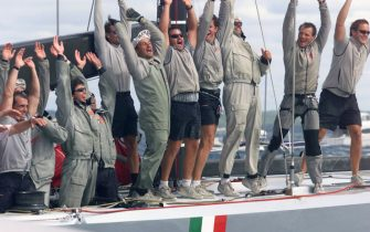 AUC12D:SPORT-YACHTING-AMERICAS:AUCKLAND,NEWZEALAND,6FEB00 - The crew of Italian yacht Prada wave to their supporters after they defeated AmericaOne to win the final race of the Louis Vuitton Cup finals on the Hauraki Gulf in Auckland February 6. Prada won the best of niine series 5-4 by 49 seconds and will meet holders Team New Zealand for the America's Cup from February 19.   mdb/Photo by Nigel Marple    REUTERS