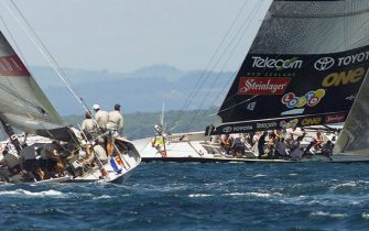 AUC15D:SPORT-YACHTING AMERICAS:AUCKLAND,NEWZEALAND,26FEB00 - Team Prada crewmen watch Team New Zealand as they chase them after rounding the  leeward mark during  race three of the America's Cup against Team New Zealand on Auckland's Hauraki Gulf February 26. Team New Zealand won by 1:39 seconds to lead  3-0 in their first defence of the America's Cup against the Italian's who are endeavoring to become the first European's to win the world's oldest sporting trophy in 149 years, in the best of nine series.    rt/Photo by Rob Taggart    REUTERS