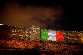 A picture taken on March 15, 2020 shows the Italian flag projected on the walls of the ramparts of Jerusalem's Old City in show of support for those suffering from coronavirus in Italy. - Italy recorded 368 new deaths from the novel coronavirus, its highest one-day increase to date, taking the total to 1,809, the most outside China, official data showed. (Photo by MENAHEM KAHANA / AFP) (Photo by MENAHEM KAHANA/AFP via Getty Images)