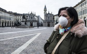 TURIN, ITALY - MARCH 16: A woman with a mask in Piazza San Carlo in Turin during on the Italy Continues Nationwide Lockdown To Control Coronavirus Spread on March 16, 2020 in Turin, Italy. Italian Government continues to enfoce the nationwide lockdown measures to control the coronavirus spread. (Photo by Stefano Guidi/Getty Images)