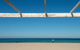 PALERMO, ITALY - MARCH 12: A general view of a semi-deserted Mondello beach on March 12, 2020 in Palermo, Italy. The Italian Government has strengthened up its quarantine rules, shutting all commercial activities except for pharmacies, food shops, gas stations, tobacco stores and news kiosks in a bid to stop the spread of the novel coronavirus. (Photo by Tullio Puglia/Getty Images)