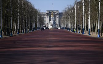 """A deserted Mall leading to Buckingham Palace is pictured in London on the morning on March 24, 2020 after Britain ordered a lockdown to slow the spread of the novel coronavirus. - Britain was under lockdown March 24, its population joining around 1.7 billion people around the globe ordered to stay indoors to curb the """"accelerating"""" spread of the coronavirus. (Photo by DANIEL LEAL-OLIVAS / AFP) (Photo by DANIEL LEAL-OLIVAS/AFP via Getty Images)"""