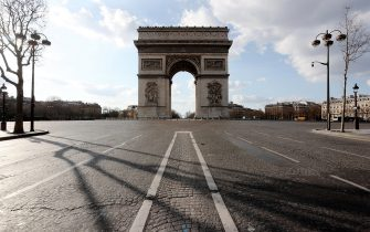 """PARIS, FRANCE-MARCH 18:  General view of the French Arc de Triomphe empty, at the end of the empty street """"Avenue des Champs Elysees, while the city imposes emergency measures to combat the Coronavirus COVID-19 outbreak, on March 17, 2020 in Paris, France. The Coronavirus Covid-19 epidemic has exceeded 6,500 dead for more than 169,000 infections across the world. During a televised speech dedicated to the coronavirus crisis on March 16, French President, Emmanuel Macron announced that France starts a nationwide lockdown on March 18 (photo by Xavier Laine/Getty Images)"""