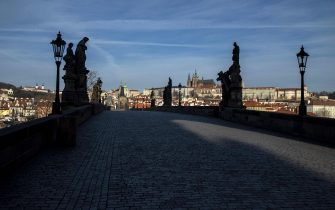 View of the empty Charles Bridge on March 16, 2020  in Prague. - The Czech government imposed new restrictions on movement to combat the spread of the coronavirus Sunday, adding to measure that have closed shops, restaurants, pubs and schools and banned gatherings of more than 30 people. (Photo by Michal Cizek / AFP) (Photo by MICHAL CIZEK/AFP via Getty Images)